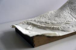 3D-printed landscape models, used in developer and government stakeholder meetings, contrast three design scenarios for a single site, including: 1) Developer's likely alignment and construction; 2) Upgrade of access road; and 3) Bioengineering and wildlife mitigation. Printed with plant-derived plastics, 2016.
