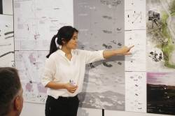 Charity Cheung, final year BA(LS) student, presenting her proposal to integrate smallholders and large agroindustry through sustainable infrastructure and landscape planning. By TSANG Yik Ming Yammi, 2014.