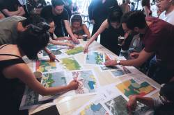 Teams play Land Development vs Conservation Hong Kong, a landscape planning game, at Storefront IS Hong Kong.