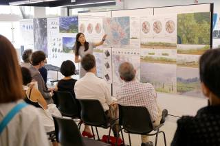Sam AU YOUNG Chung Yan defends her landscape planning proposal for equitable land rights for peoples displaced large-scale agroindustry during the Faculty of Architecture's Public Review, 2015.